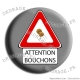 Badge Attention bouchons